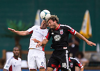 Chris Tierney () of the New England Revolution goes up for a header with Nick DeLeon (18) of D.C. United during a Major League Soccer game at RFK Stadium in Washington, DC.  New England defeated D.C. United, 2-1.