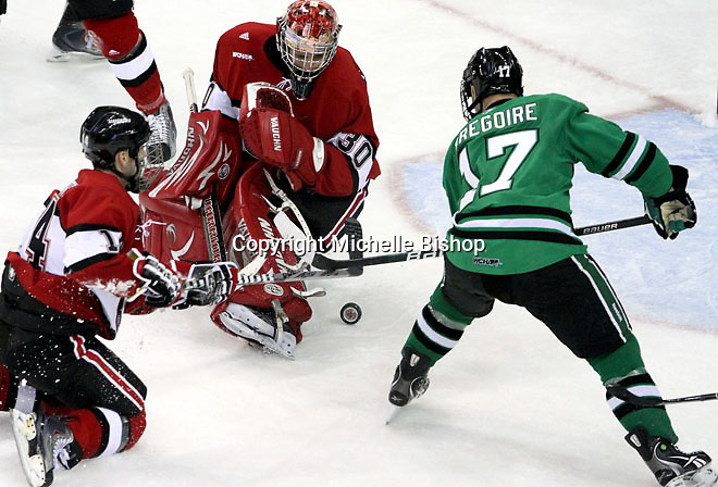 UNO goalie John Faulkner watches as the puck rolls toward North Dakota's Jason Gregoire during the second period. No. 4 UNO beat No. 7 North Dakota 1-0 Saturday night at Qwest Center Omaha. (Photo by Michelle Bishop)