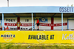 A fan studying he banners in one of the stands. Yorkshire v Parishes of Jersey, CONIFA Heritage Cup, Ingfield Stadium, Ossett. Yorkshire's first competitive game. The Yorkshire International Football Association was formed in 2017 and accepted by CONIFA in 2018. Their first competative fixture saw them host Parishes of Jersey in the Heritage Cup at Ingfield stadium in Ossett. Yorkshire won 1-0 with a 93 minute goal in front of 521 people. Photo by Paul Thompson