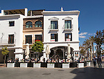People sitting outside cafe at popular holiday resort town of Nerja, Malaga province, Spain