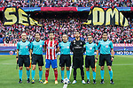 Gabriel Fernandez Arenas, Gabi (3rd from left), of Atletico de Madrid and Sergio Ramos (3rd from right) of Real Madrid line up and pose for a photo with referee Cuneyt Cakir (c) and the assistant referees Baris Simsek (l), Tarik Ongun (2nd from left), Bahattin Duran (2nd from right) and Ali Palabiyik (r) prior to their 2016-17 UEFA Champions League Semifinals 2nd leg match between Atletico de Madrid and Real Madrid at the Estadio Vicente Calderon on 10 May 2017 in Madrid, Spain. Photo by Diego Gonzalez Souto / Power Sport Images