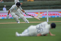 NZ's Ross Taylor makes his ground as Zak Crawley stumbles chasing the ball during day five of the international cricket 2nd test match between NZ Black Caps and England at Seddon Park in Hamilton, New Zealand on Tuesday, 3 December 2019. Photo: Dave Lintott / lintottphoto.co.nz