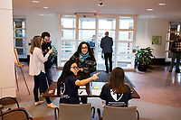 Meredith Davis, 26, (right, seated at table) and Claris Chang, 25, both Master in Public Policy grad students at Harvard, register attendees before a session of Resistance School at Harvard University's John F. Kennedy School of Government, on Thurs., April 27, 2017.