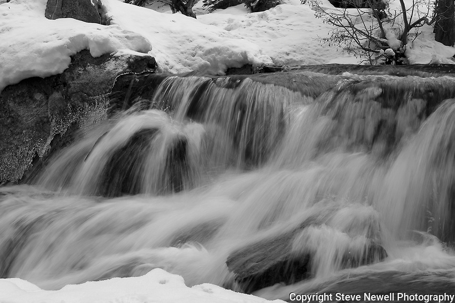 """""""Eagles Flow""""   Eagle Falls waterfall at Emerald Bay, Lake Tahoe, CA.  I hiked out to Lower Eagle Falls above Emerald Bay during the Winter of 2013. The road was closed due to avalanche danger so I had the whole area to myself for the entire day.  Emerald Bay may be the most visited and photographed area in all of Lake Tahoe but on a few days you can enjoy the beauty in solitude. I shot both stills and HD 1080 video of the waterfall and Emerald Bay."""