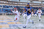 BROOKINGS, SD - NOVEMBER 17: Cade Johnson #15 from South Dakota State University crosses the goal line in front of Jakari Starling #27 from the University of South Dakota during their game Saturday afternoon at Dana J. Dykhouse Stadium in Brookings, SD. (Photo by Dave Eggen/Inertia)