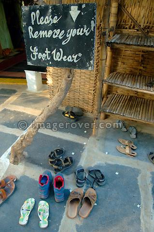 "Sign reading ""please remove your footwaer"" at Cafe Mango Tree in Hampi, Karnataka, India."