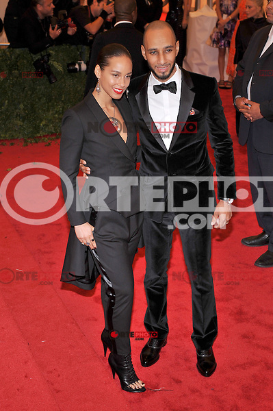Alicia Keys and Swizz Beats at the 'Schiaparelli And Prada: Impossible Conversations' Costume Institute Gala at the Metropolitan Museum of Art on May 7, 2012 in New York City. ©mpi03/MediaPunch Inc.
