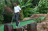 United States President Barack Obama plays miniature golf with First Lady Michelle and daughter Sasha (off camera) at Pirate's Island Miniature Golf in Panama City Beach, Florida USA on Saturday, 14 August  2010.  The First Family is visiting the area to help promote tourism and check up on clean up efforts from the aftermath of the Deepwater Horizon Oil spill. .Credit: Dan Anderson / Pool via CNP