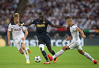 Tiemoue Bakayoko of Monaco avoids Eric Dier of Tottenham Hotspur & Erik Lamela (right) of Tottenham Hotspur during the UEFA Champions League Group stage match between Tottenham Hotspur and Monaco at White Hart Lane, London, England on 14 September 2016. Photo by Andy Rowland.