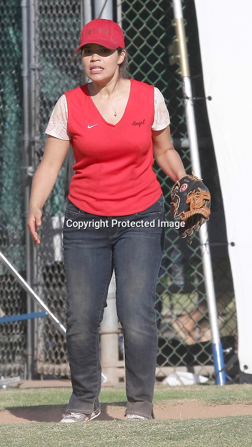 .6-2-09.AMERICA FERRERA PLAYING BASEBALL SOFTBALL FOR HER NEW MOVIE CALLED FAMILY WEDDING IN LOS ANGELES CALIFORNIA. THE Wardrobe DEPARTMENT had to keep tucking her underwear back in HER PAINTS & TAPPING make up on her breasts. FOREST WHITAKER WAS STRETCHING & CARLOS MENCIA WERE ALSO ON SET WEARING RED JERSEYS. ..AbilityFilms@yahoo.com.805-427-3519.www.AbilityFilms.com