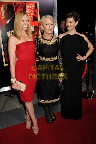 """Toni Collette, Helen Mirren & Jessica Biel (wearing Gucci).""""Hitchcock"""" Los Angeles Premiere held at the AMPAS Samuel Goldwyn Theater, Beverly Hills, California, USA..November 20th, 2012.full length dress black gold embroidered collar lace red one arm around waist  over shoulder nude beige clutch bag shoes tights smiling hand on hip frills ruffle sleeveless halterneck .CAP/ADM/BP.©Byron Purvis/AdMedia/Capital Pictures."""