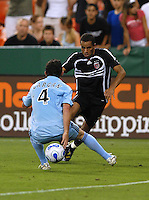 DC United midfielder Fred (7) tries to dribble the ball against Colorado Rapids defender Dan Gargan (4). DC United defeated Colorado Rapids 4-1, at RFK Stadium in Washington DC, Thursday June 28, 2007.