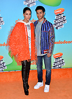 LOS ANGELES, CA. March 23, 2019: Naomi Scott & Mena Massoud  at Nickelodeon's Kids' Choice Awards 2019 at USC's Galen Center.<br /> Picture: Paul Smith/Featureflash