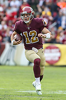 Landover, MD - November 18, 2018: Washington Redskins quarterback Colt McCoy (12) runs the ball during the  game between Houston Texans and Washington Redskins at FedEx Field in Landover, MD.   (Photo by Elliott Brown/Media Images International)