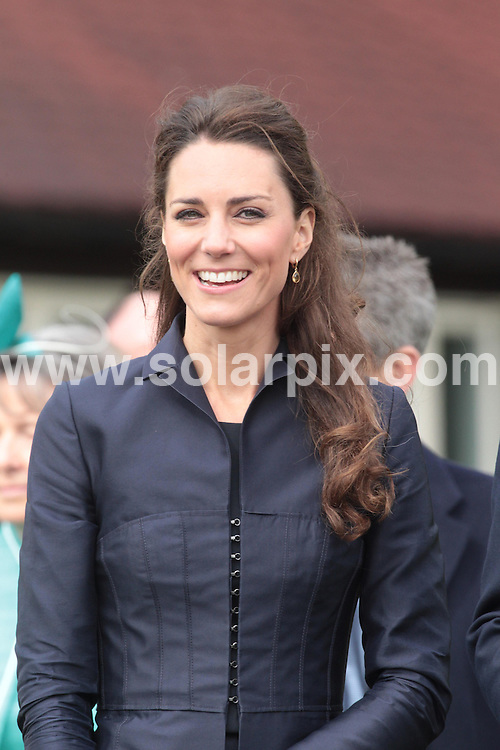 **ALL ROUND PICTURES FROM SOLARPIX.COM**                                             **NO UK NEWSPAPER PUBLICATION**.**UK MAGAZINE & SUPPLEMENT PUBLICATION ONLY** AND NO PUBLICATION IN AUSTRALIA, BELGIUM, FRANCE, GERMANY, ITALY, SCANDINAVIA AND USA**                                                                                  Caption: Royal fans greet Kate Middleton and Prince William at Witton Country Park in Darwen, Blackburn today. Their last official engagement before their wedding. Blackburn, UK. 11 April 2011                                                                              This pic: Kate Middleton                                                                               JOB REF: 13125 SFE       DATE: 11_04_2011                                                           **MUST CREDIT SOLARPIX.COM OR DOUBLE FEE WILL BE CHARGED**                                                                      **MUST AGREE FEE BEFORE ONLINE USAGE**                               **CALL US ON: +34 952 811 768 or LOW RATE FROM UK 0844 617 7637**