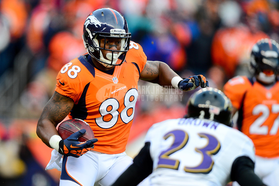 Jan 12, 2013; Denver, CO, USA; Denver Broncos wide receiver Demaryius Thomas (88) runs the ball in the first half against the Baltimore Ravens during the AFC divisional round playoff game at Sports Authority Field.  Mandatory Credit: Mark J. Rebilas-