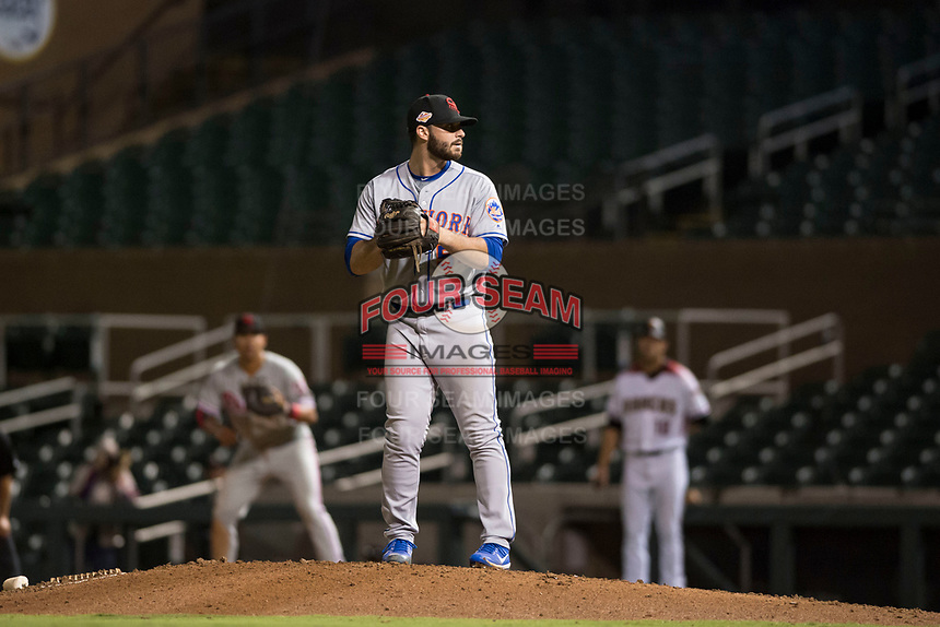 Scottsdale Scorpions relief pitcher Joe Zanghi (54), of the New York Mets organization, gets ready to deliver a pitch during an Arizona Fall League game against the Salt River Rafters at Salt River Fields at Talking Stick on October 11, 2018 in Scottsdale, Arizona. Salt River defeated Scottsdale 7-6. (Zachary Lucy/Four Seam Images)