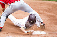 Kevin Medrano (13) of the Missouri State Bears slides into third base during a game against the Bradley Braves on May 13, 2011 at Hammons Field in Springfield, Missouri.  Photo By David Welker/Four Seam Images