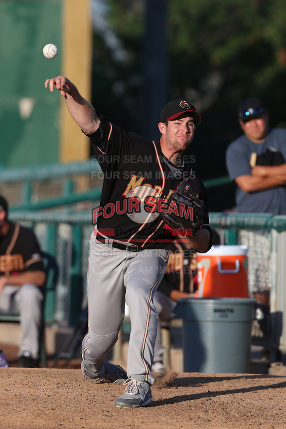 Devin Burke #41 of the Modesto Nuts warms up in the bullpen before pitching against the Inland Empire 66ers at San Manuel Stadium on May 28, 2014 in San Bernardino, California. Modesto defeated Inland Empire, 3-2. (Larry Goren/Four Seam Images)
