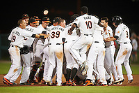 Frederick Keys left fielder Jay Gonzalez (hidden) is mobbed by teammates, including Erick Saucedo (19), Luis Gonzalez (48), Wynston Sawyer (14), Cameron Kneeland (39), Aderlin Rodriguez (9), Jonah Heim (6), Josh Hart (10), TJ Olesczuk (3), after a walk off base hit during a game against the Carolina Mudcats on June 4, 2016 at Nymeo Field at Harry Grove Stadium in Frederick, Maryland.  Frederick defeated Carolina 5-4 in eleven innings.  (Mike Janes/Four Seam Images)