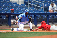 Charlotte Stone Crabs third baseman Cristian Toribio (16) waits for a throw as Allen Staton (33) slides into third during a game against the Palm Beach Cardinals on April 10, 2016 at Charlotte Sports Park in Port Charlotte, Florida.  Palm Beach defeated Charlotte 4-1.  (Mike Janes/Four Seam Images)