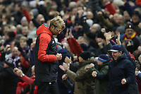 Liverpool Manager Jurgen Klopp pumps hi fist in celebration after James Milner scores from the penalty spot during the Barclays Premier League Match between Liverpool and Swansea City played at Anfield, Liverpool on 29th November 2015