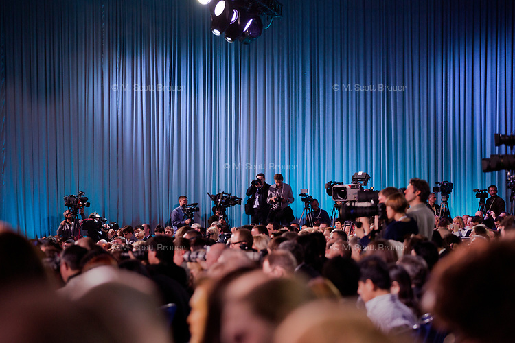 Journalists listen to Russian president Vladimir Putin at his annual press conference in Moscow, Russia.  The press conference lasted 5 hours.