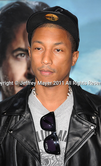 WESTWOOD, CA - DECEMBER 06: Pharrell Williams attends the Los Angeles premiere of 'Sherlock Holmes: A Game Of Shadows' at Regency Village Theatre on December 6, 2011 in Westwood, California.