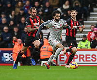 Liverpool's Mohamed Salah (right) under pressure from Bournemouth's Steve Cook (left) <br /> <br /> Photographer David Horton/CameraSport<br /> <br /> The Premier League - Bournemouth v Liverpool - Saturday 8th December 2018 - Vitality Stadium - Bournemouth<br /> <br /> World Copyright © 2018 CameraSport. All rights reserved. 43 Linden Ave. Countesthorpe. Leicester. England. LE8 5PG - Tel: +44 (0) 116 277 4147 - admin@camerasport.com - www.camerasport.com