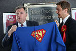 "© Joel Goodman - 07973 332324 . 11/04/2015 . Bury , UK . Labour Shadow Chancellor Ed Balls (l) and James Frith (c) , Labour candidate for Bury North , at a campaign stop at Barista coffee shop at The Rock , Bury in Greater Manchester , UK . Pictured holding a "" Super Josh "" brain tumour charity sweatshirt . The pair met parents and discussed family finances . Photo credit : Joel Goodman"