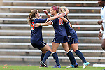 28 October 2012: Virginia's Caroline Miller (10) celebrates her goal with Morgan Brian (6) and Danielle Colaprico (right). The University of North Carolina Tar Heels played the University of Virginia Cavaliers at Fetzer Field in Chapel Hill, North Carolina in a 2012 NCAA Division I Women's Soccer game. Virginia defeated UNC 1-0 in their Atlantic Coast Conference quarterfinal match.