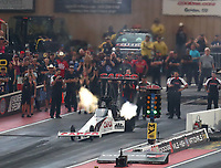 Jul 21, 2018; Morrison, CO, USA; Crew members look on as NHRA top fuel driver Steve Torrence launches off the starting line during qualifying for the Mile High Nationals at Bandimere Speedway. Mandatory Credit: Mark J. Rebilas-USA TODAY Sports
