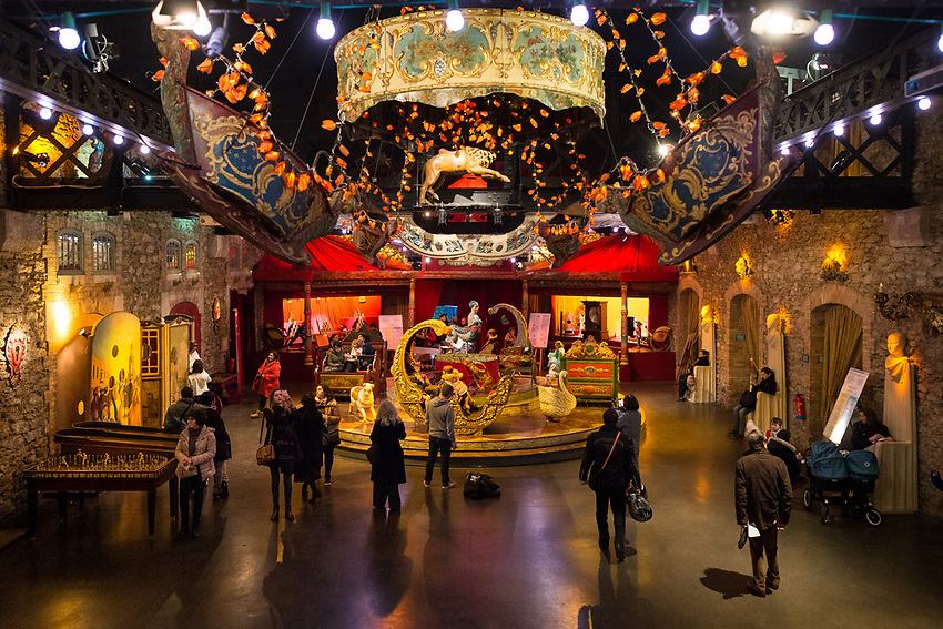 """The Festival du Merveilleux at the Musée des Arts Forains in the Pavillons de Bercy, in the12th Arrondissement of Paris at 53, Avenue des Terroirs de France. The Musée des Arts Forains is a spectacular and very unusual private museum created and owned by Jean-Paul Favand in the old wines stores of Paris, to house his huge collection of 19th and 20th century fairground objects and cabaret memorabilia. It is also a museum for events and spectacles. As Jean-Paul Favand remarks, """"There were plenty of museums dedicated to war. There was no museum for laughter and merriment. I have created a dream world that is brought to life by those who visit."""" The Musée des Arts Forains is a timeless escape from the world of reality. A wonderland visit to a cabinet de curiosités. A Grand Meaulnes discovery of an enchanted domaine. Phantoms, Unicorns, musical instruments that play with no human hand. Fantastical gardens. Fairground manèges from the Belle Epoque. And all the more special since you can join the magical moment: ride the hundred year old fairground roundabouts, compete on the antique games. The visitors themselves become the actors in the scene. Saturday and Sunday 6th and 7th January 2018. Photograph by Andrew Lyndon-Skeggs of ANLS Photography www.anlsphotography.photoshelter.com"""