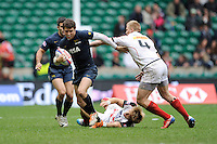 Franco Sabato of Argentina finds a way past the tackle of John Moonlight of Canada during Day Two of the iRB Marriott London Sevens at Twickenham on Sunday 11th May 2014 (Photo by Rob Munro)