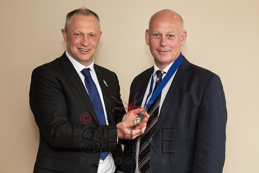 Outgoing Nottingham City Business Club president Mark Deakin hands over the President's medallion to Ian Roberts
