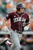 Texas A&M Aggies designated hitter Matt Juengel #17 runs to first base against the Texas Longhorns in NCAA Big XII Conference baseball on May 21, 2011 at Disch Falk Field in Austin, Texas. (Photo by Andrew Woolley / Four Seam Images)