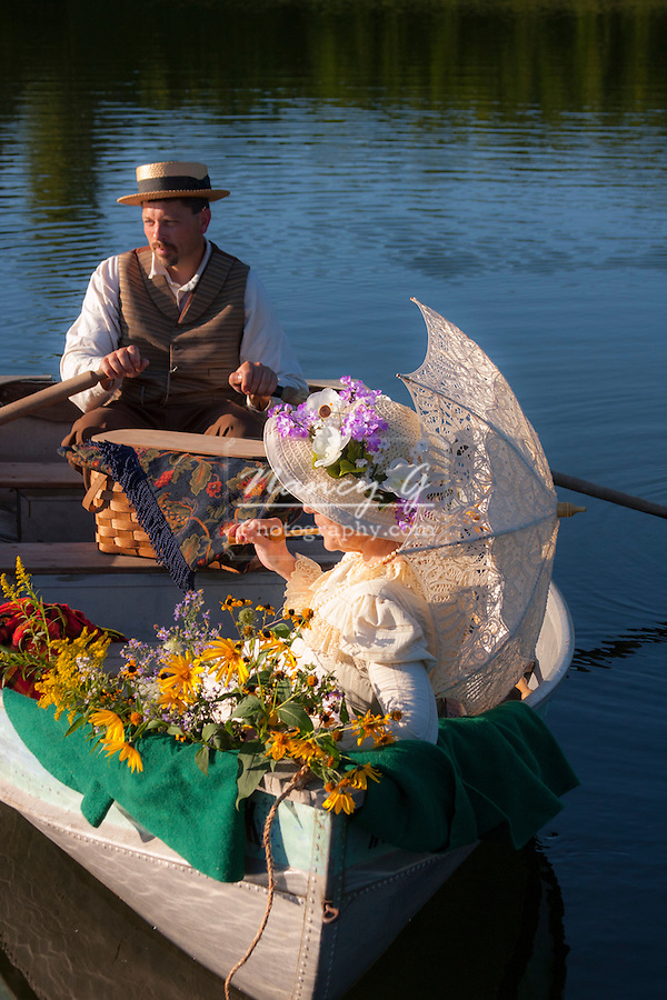 Victorian Couple in a rowboat at sunset