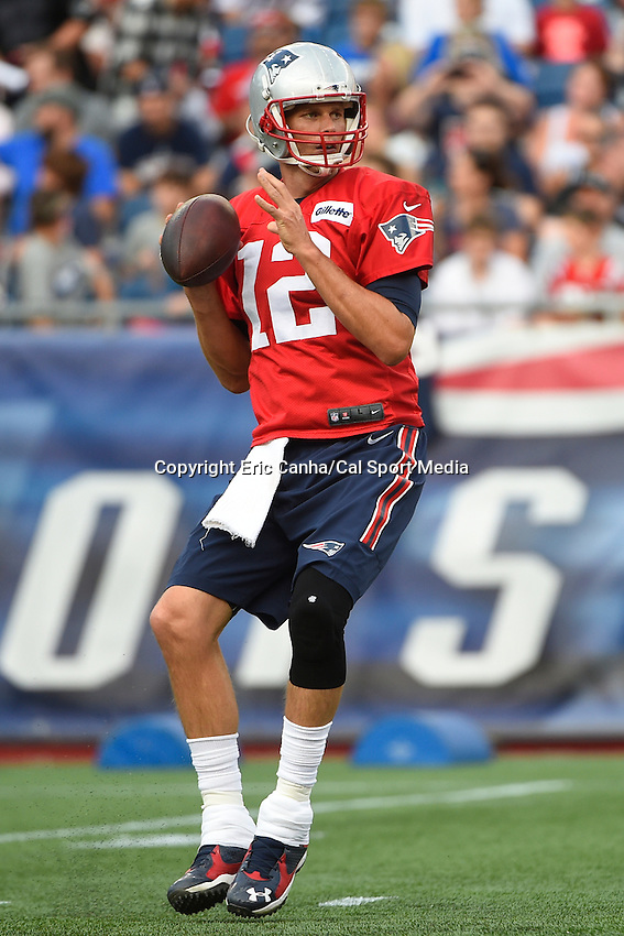 August 5, 2015: New England Patriots quarterback Tom Brady (12) looks for a receiver during the New England Patriots training camp held on the the game field at Gillette Stadium in Foxborough Massachusetts. Eric Canha/CSM