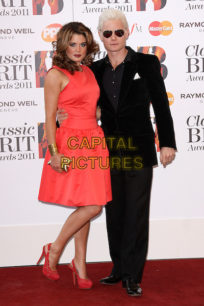 COURTENAY HAMILTON (Miss wales 2010) & RHYDIAN ROBERTS.Arriving to the Classical Brit Awards 2011 at the Royal Albert Hall, London, England, UK, 12th May 2011..arrivals brits full length black suit red dress sleeveless  shoes gold cuff  velvet jacket sunglasses .CAP/AH.©Adam Houghton/Capital Pictures.