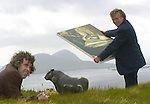 Overlooking The Blasket Islands are artists Anthony Scott, left and Tomas O'Ciobhain  with art  from a joint exhibition at The Greenlane Gallery in Dingle which was opened at the weekend and runs until early June.<br /> Picture by Don MacMonagle