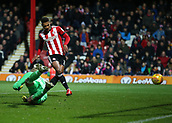2nd December 2017, Griffen Park, Brentford, London; EFL Championship football, Brentford versus Fulham; Ollie Watkins of Brentford shoots to score his sides 3rd goal in the 84th minute to make it 3-1 past Goalkeeper David Button of Fulham