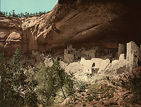 Cliff Palace, 1898, colour photochrom print, in the Chapin Mesa Archeological Museum, in Mesa Verde National Park, Montezuma County, Colorado, USA. Cliff Palace, 13th century, is a huge multi-storey Native American Puebloan dwelling, housing 125 people, with 23 kivas and 150 rooms, rediscovered in 1888. It is the largest cliff house in the park, possibly used for social and ceremonial purposes and is thought to be part of a larger community encompassing 60 pueblos and 600 people. It is made from sandstone blocks, mortar and wooden beams and was originally painted with earthen plasters. Mesa Verde is the largest archaeological site in America, with Native Americans inhabiting the area from 7500 BC to 13th century AD. It is listed as a UNESCO World Heritage Site. Picture by Manuel Cohen