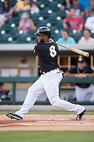 Emelio Bonifacio (8) of the Charlotte Knights follows through on his swing against the Gwinnett Braves at BB&T BallPark on August 11, 2015 in Charlotte, North Carolina.  The Knights defeated the Braves 3-2.  (Brian Westerholt/Four Seam Images)