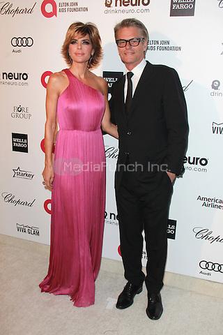 WEST HOLLYWOOD, CA - FEBRUARY 22: Lisa Rinna and Harry Hamlin at the 2015 Elton John AIDS Foundation Oscar Party in West Hollywood, California on February 22, 2015. Credit: David Edwards/DailyCeleb/MediaPunch