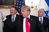 US President Donald J. Trump (C) delivers remarks, flanked by US Secretary of State Mike Pompeo (L) and US Vice President Mike Pence (R), while hosting Prime Minister of Israel Benjamin Netanyahu (unseen) in the Diplomatic Reception Room of the White House in Washington, DC, USA, 25 March 2019. Trump signed an order recognizing Golan Heights as Israeli territory.<br /> Credit: Michael Reynolds / Pool via CNP
