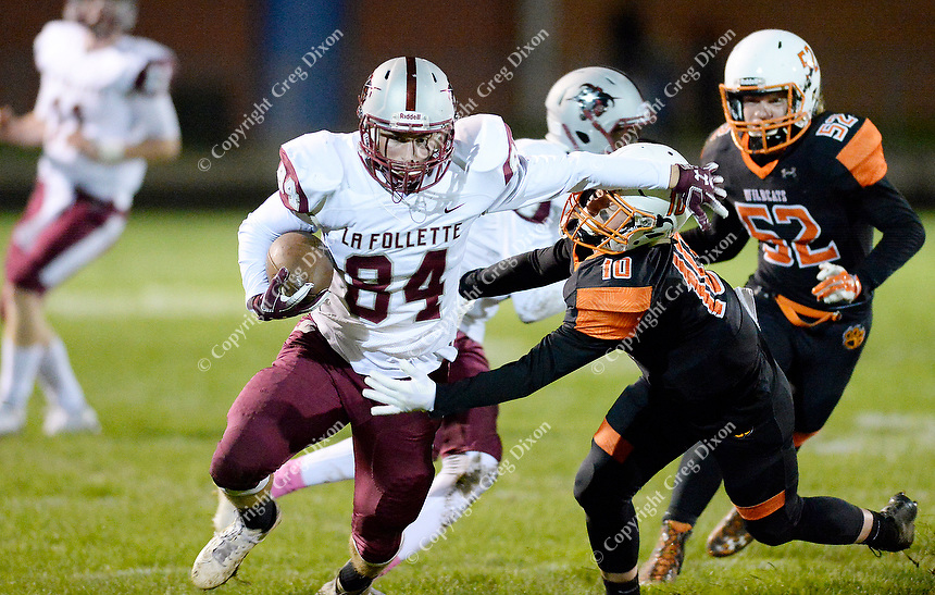 La Follette's Andrew Rajkovich escapes a tackle by Verona's Cam McCorkle (10), as Madison La Follette takes on Verona in Wisconsin Big Eight Conference high school football on Friday, 10/4/19 at Verona High School's Curtis Jones Field