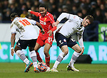 Raheem Sterling of Liverpool tries to link past Neil Danns and Dorian Dervite of Bolton Wanderers - FA Cup Fourth Round replay - Bolton Wanderers vs Liverpool - Macron Stadium  - Bolton - England - 4th February 2015 - Picture Simon Bellis/Sportimage