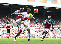 Wayne Routledge of Swansea battles with Cheikhou Kouyate of West Ham United   during the Barclays Premier League match between West Ham United and Swansea City  played at Boleyn Ground , London on 7th May 2016