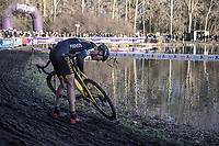 Toon Aerts (BEL/Telenet Fidea Lions) fixing his bike after crashing on the slippery mud.<br /> <br /> men's elite race<br /> Flandriencross Hamme / Belgium 2017