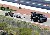 Mar 30, 2014; Las Vegas, NV, USA; NHRA top fuel driver Shawn Langdon being towed down the return road by his Toyota SUV during the Summitracing.com Nationals at The Strip at Las Vegas Motor Speedway. Mandatory Credit: Mark J. Rebilas-